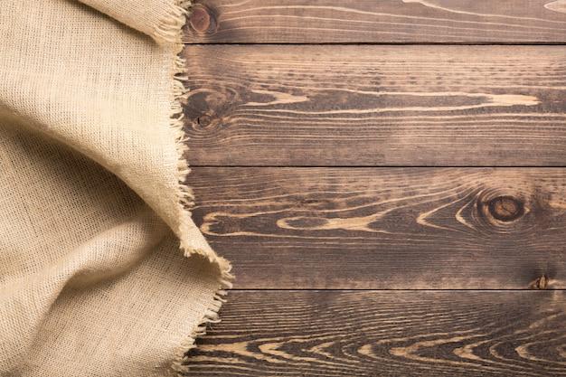 Jutejute het ontslaan doek op houten lijstachtergrond met vrije ruimte.