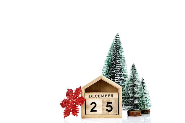 Kalender met de datum van kerstmis op witte muur