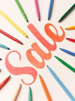 Kalligrafie belettering verkoop tussen markeringen