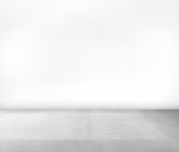 Kamer gemaakt van witte muur en betonnen vloer