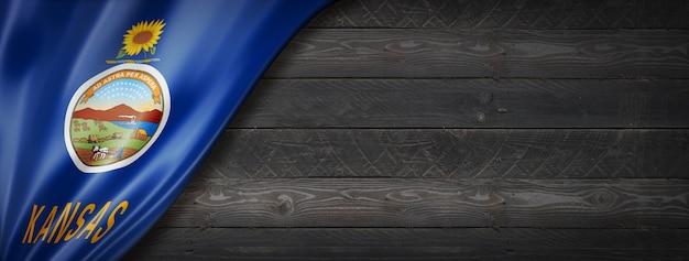 Kansas vlag op zwarte houten muur banner, usa. 3d illustratie