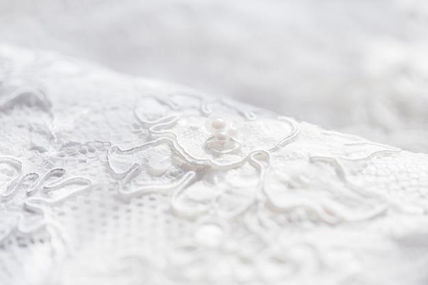 Kanten zijden stof met knopen
