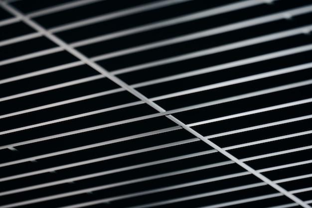 Kantoorrooster plafond. modern zwart metalen roosterplafond. abstracte textuur.