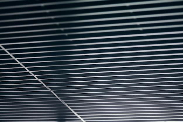 Kantoorrooster plafond. modern zwart metalen roosterplafond, hangende bekleding. abstracte ontwerptextuur.