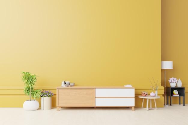 Kast voor tv of plaats object in moderne woonkamer met lamp, tafel, bloem en plant op gele muur