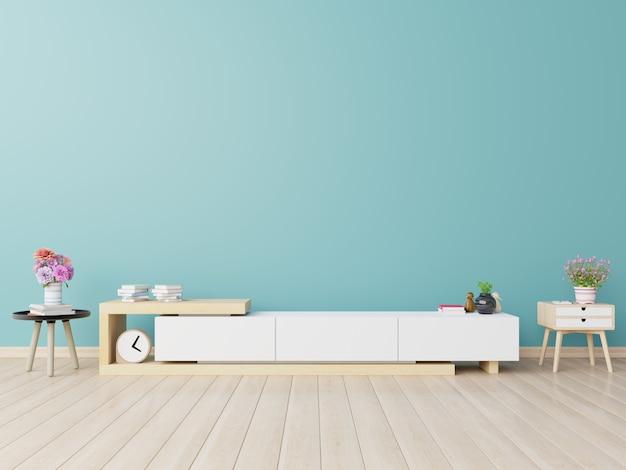 Kasten voor tv in een kamer, blauwe muren.