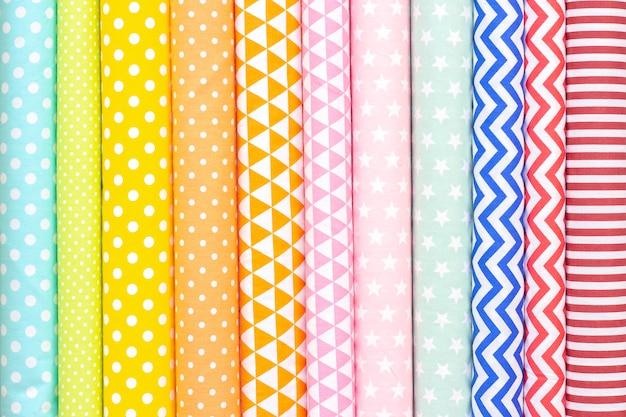 Katoen lichte tinten stof textuur. roze, oranje, gele, turquoise kleuren