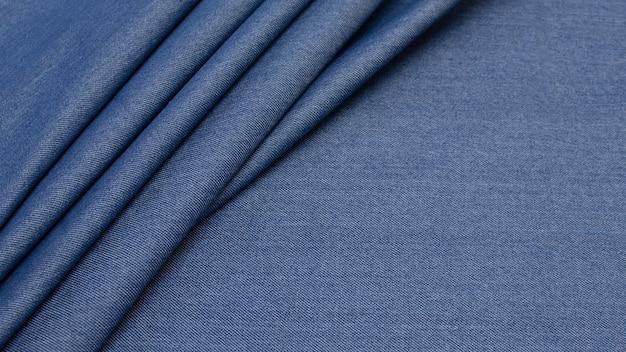 Katoenen stof. jeans. de kleur is blauw. textuur,