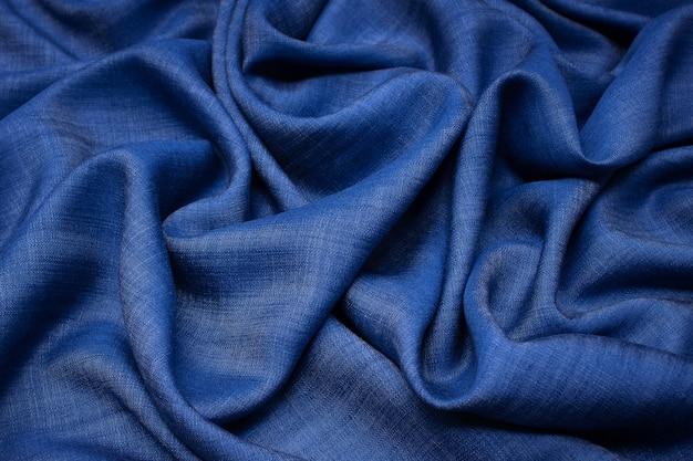 Katoenen stof. jeans donkerblauwe kleur. textuur, achtergrond, patroon.