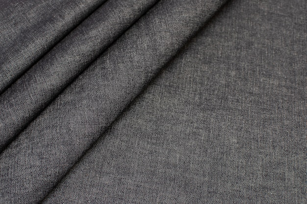 Katoenen stof. jeans. zwarte kleur. textuur,