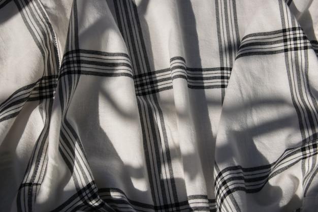 Katoenen structuurstof of stoffen textiel met kooi.