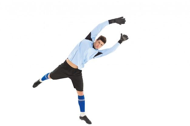 Keeper in blauw omhoog springen