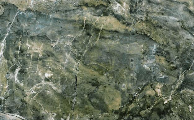 Keramische bruine tegel met ruw abstract stenen oppervlaktepatroon