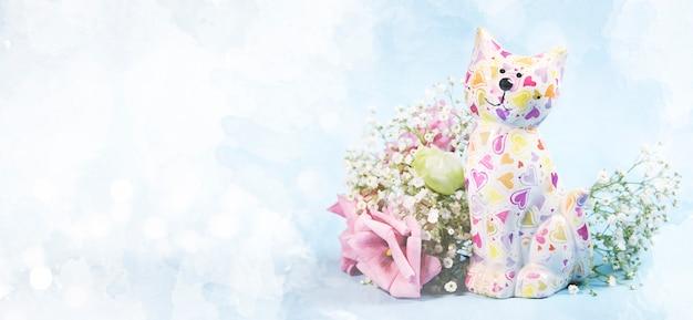 Keramische kat met bloemen