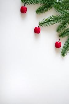 Kerst achtergrond met groene fir takken en dennenappels