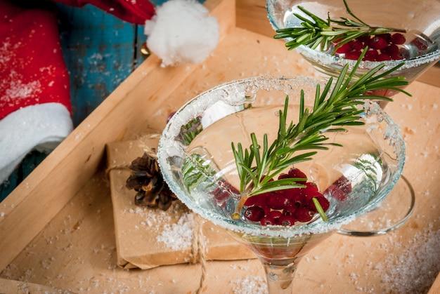 Kerst cocktail met veenbessen en rozemarijn