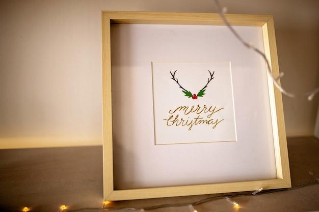 Kerst concept decor belettering in frame