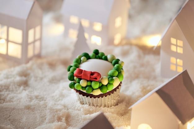 Kerst cupcakes op sneeuwstad