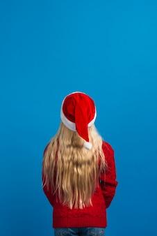 Kerst meisje terug geschoten met kopie ruimte