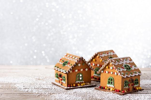 Kerst peperkoek huis op glitter achtergrond