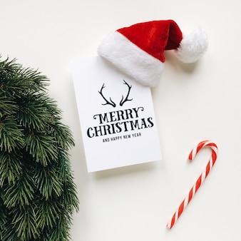 Kerst samenstelling van de kerstman hoed en wenskaart