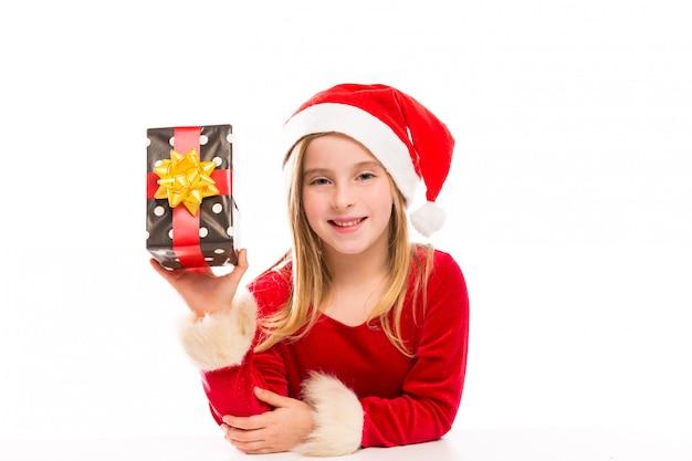 Kerst santa jongen meisje blij opgewonden met lint geschenk