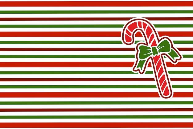 Kerst snoepgoed op gestreepte inpakpapier achtergrond. rode en groene strepen. kerst patroon