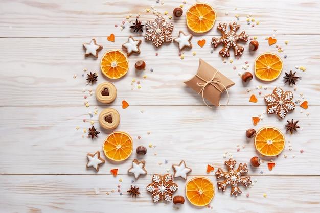Kerst vakantie krans achtergrond met geschenkdoos