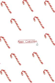 Kerst wenskaart. witte achtergrond. nieuwjaar symbool. kerst snoep kegel. patroon