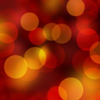 Kerstachtergrond van rode en gouden bokehlichten
