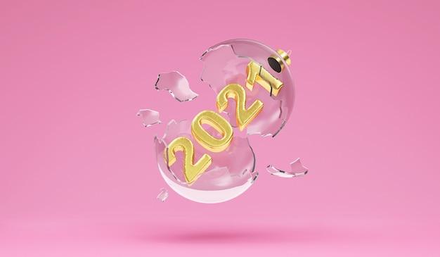 Kerstbal van gebroken glas met gouden nieuwjaar symbool binnen