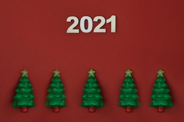 Kerstboom inscriptie op een rode achtergrond