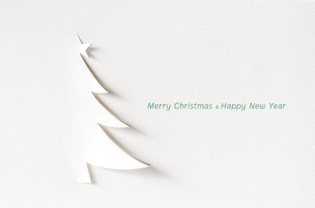 Kerstboomdocument scherpe ontwerpkaart. kerst papier ambacht.