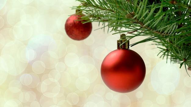 Kerstboomtak met rode ballen