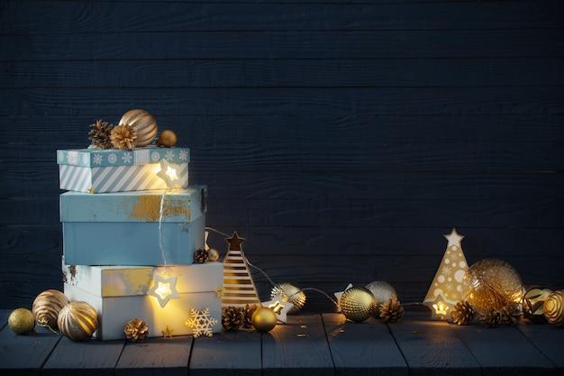 Kerstcadeaus met gouden versieringen op blauwe houten achtergrond