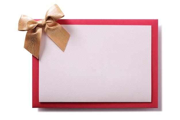 Kerstkaart gouden boog rode envelop
