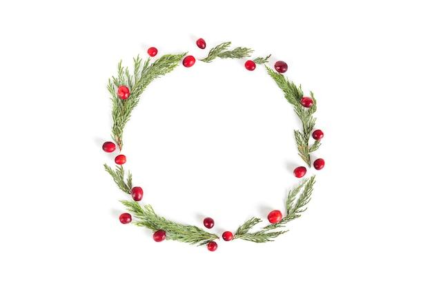 Kerstkrans frame met veenbessen, plat lag, bovenaanzicht.