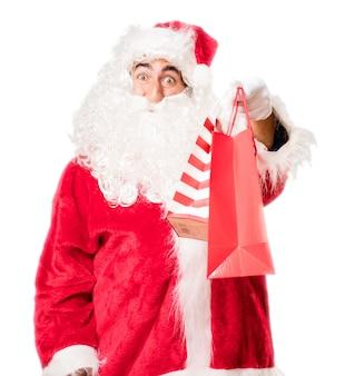 Kerstman die aankoop zakken