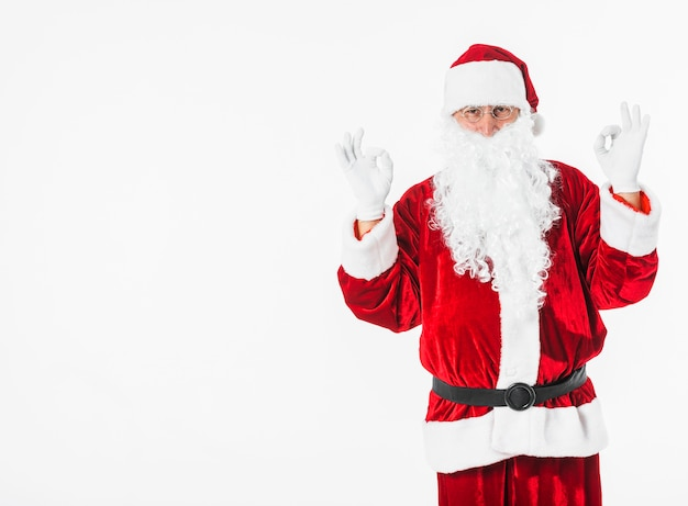 Kerstman die ok gebaar toont