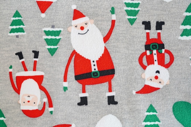 Kerstman en kerstboom op stoftextur