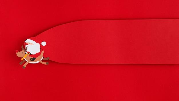Kerstman en rendieren vliegende kopie ruimte label