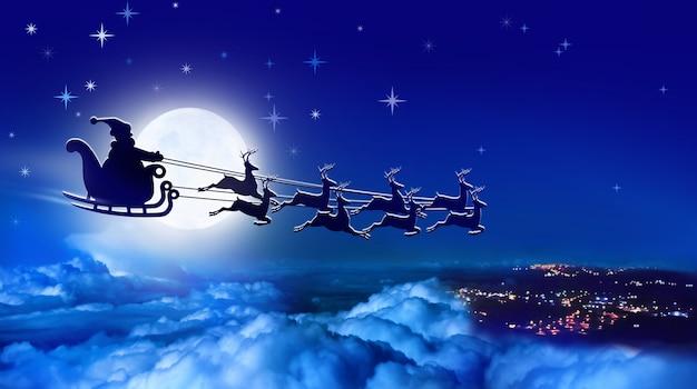 Kerstman in een slee en rendierslee vliegt over de aarde op de achtergrond van volle maan in de nachtelijke hemel