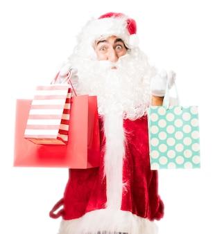 Kerstman met aankoop zakken