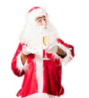 Kerstman met een glas wijn