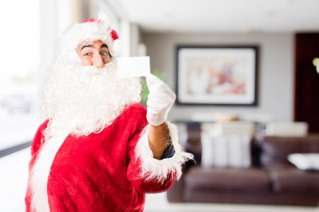 Kerstman met een klein bordje