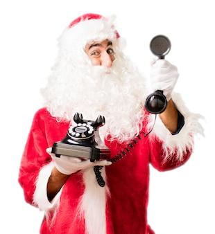 Kerstman met een oude telefoon