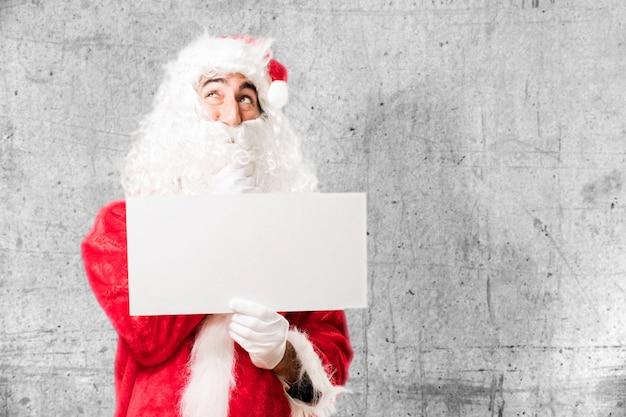 Kerstman met een witte poster