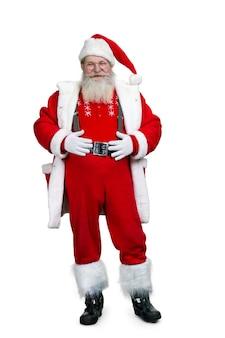 Kerstman met handen op buik.