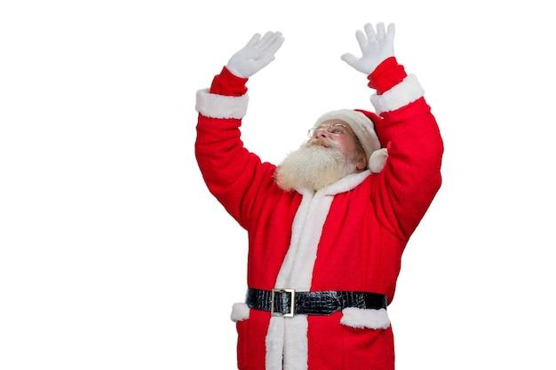 Kerstman met opgeheven handen, witte achtergrond.