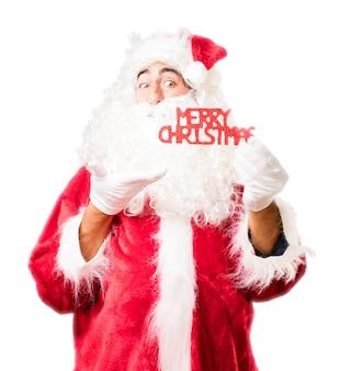 Kerstman met teksten die zeggen: